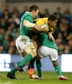 Peter O'Mahony and Conor Murray tackle Israel Folau