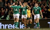 Simon Zebo celebrates scoring his side's first try with Tommy Bowe and Robbie Henshaw