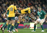 Israel Folau is tackled by Tommy Bowe