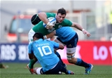 Six Nations newcomer Robbie Henshaw, who was winning his sixth Ireland cap, is tackled by Italy's Kelly Haimona and Francesco Minto Credit: ©INPHO/Dan Sheridan