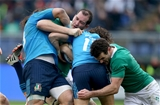 Ireland second row Devin Toner is tackled by Italy's Martin Castrogiovanni and Luke McLean Credit: ©INPHO/Dan Sheridan