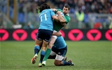 Ireland full-back Rob Kearney is tackled by Italy's Luke McLean and Kelly Haimona Credit: ©INPHO/Ryan Byrne