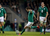 Forwards Mike Ross and Devin Toner look as Jonathan Sexton aims a place-kick towards the posts Credit: ©INPHO/Dan Sheridan
