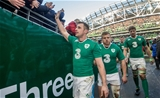 Ireland winger Tommy Bowe celebrates with the fans as the players make their way off the pitch Credit: ©INPHO/James Crombie