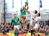 Jared Payne looks on as his Ireland team-mate Simon Zebo wins a high ball Credit: ©INPHO/Colm O'Neill