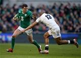 Ireland out-half Jonathan Sexton tries to hand off England's Jonathan Joseph Credit: ©INPHO/Dan Sheridan