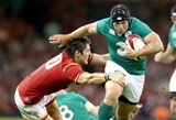 Richardt Strauss tries to barge through a tackle from Wales' James Hook Credit: ©INPHO/Dan Sheridan