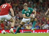 Chris Henry, who replaced Jamie Heaslip in the back row, makes a carry during the second half Credit: ©INPHO/Billy Stickland
