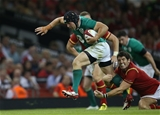 Richardt Strauss is tackled by Wales out-half James Hook Credit: ©INPHO/Billy Stickland