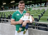 Gordon D'Arcy holds his baby daughter Soleil after playing his part in Ireland's 28-22 win over Scotland Credit: ©INPHO/Dan Sheridan