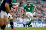 Ian Madigan fires his cross-field kick over to the left wing where Luke Fitzgerald collected it to run in Ireland's fourth try Credit: ©INPHO/James Crombie