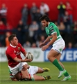 Ian Keatley looks to get an offload away with his opposite number Sam Christie defending for Treviso Credit: ©INPHO/Ryan Byrne