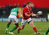 Munster centre Rory Scannell gets his pass away under pressure from Treviso's Tommaso Iannone Credit: ©INPHO/Ryan Byrne