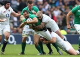 Dave Kearney, the liveliest of the Ireland backs in attack, is tackled by England's Joe Marler and Ben Youngs Credit: ©INPHO/Billy Stickland