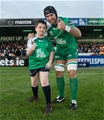 Connacht captain John Muldoon gives the thumbs up with team mascot Hayden Murphy Credit: ©INPHO/James Crombie