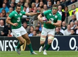 Jamie Heaslip is supported by in-form winger Dave Kearney as he carries the ball forward Credit: ©INPHO/Billy Stickland