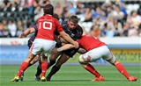 Ospreys hooker Sam Parry charges at Munster duo Jack O'Donoghue and Tyler Bleyendaal Credit: ©INPHO/Ian Cook