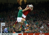 Luke Fitzgerald, who lined out in the centre alongside Jared Payne, competes for a high ball with Canadian full-back Matt Evans Credit: ©INPHO/Billy Stickland