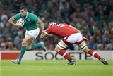 Rob Kearney gets by Canadian captain Jamie Cudmore Credit: ©INPHO/Dan Sheridan