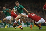 Luke Fitzgerald, who started at inside centre, tries to get past Canada's Brett Beukeboom Credit: ©INPHO/Billy Stickland