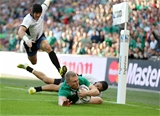 Keith Earls dives over to score for Ireland and move his side into an 18-3 lead Credit: ©INPHO/Dan Sheridan