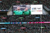 Ireland forwards Cian Healy and Jordi Murphy are pictured singing 'Ireland's Call' on the big screen Credit: ©INPHO/Billy Stickland