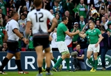 Devin Toner celebrates with Keith Earls after the fleet-footed winger crossed for Ireland's third try and his second of the day Credit: ©INPHO/James Crombie