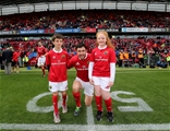 Munster captain Felix Jones is pictured before kick-off with the two team mascots Credit: ©INPHO/Ryan Byrne