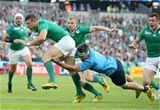Rugby World Cup debutant Robbie Henshaw is tackled by lively Italian flanker Simone Favaro Credit: ©INPHO/Dan Sheridan