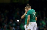 A tearful Ian Madigan is pictured with Robbie Henshaw after the final whistle Credit: ©INPHO/James Crombie