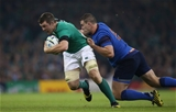 The determination is etched on Peter O'Mahony's face as he tries to break away from France number 8 Louis Picamoles Credit: ©INPHO/Billy Stickland