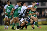 Kieran Marmion, who started in the number 9 jersey for Connacht, is tackled by Zebre's Jacopo Sarto and Matteo Pratichetti Credit: ©INPHO/James Crombie