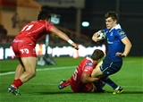 Leinster's young right winger Garry Ringrose is tackled by the Scarlets' Aled Thomas Credit: ©INPHO/Ian Cook
