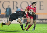 Munster backs David Johnston and Andrew Conway combine to tackle the Scarlets' Aled Thomas Credit: ©INPHO/Paul Jenkins