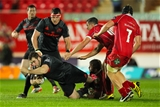 Munster prop James Cronin is brought to ground by the Scarlets' John Barclay Credit: ©INPHO/Paul Jenkins