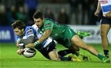 Connacht winger Tiernan O'Halloran gets a tackle in on Benetton Treviso's Simone Ragusi Credit: ©INPHO/Morgan Treacy