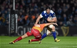 Sean O'Brien, who returned to the Leinster back row, takes on Scarlets out-half Dan Jones Credit: ©SPORTSFILE/Ramsey Cardy