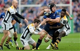 Leinster flanker Sean O'Brien looks for support as he is tackled by Wasps' Elliot Daly and Christian Wade Credit: ©INPHO/Ryan Byrne