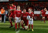 Munster captain CJ Stander is pictured with the team mascots before kick-off Credit: ©INPHO/Ryan Byrne