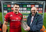 Munster's CJ Stander receives his Champions Cup man-of-the-match award from Pat Maher of Heineken Credit: ©INPHO/Cathal Noonan