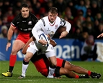 Ulster flyer Craig Gilroy is caught in possession by Saracens' England-capped loosehead Mako Vunipola Credit: ©INPHO/Presseye/Brian Little
