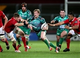 Connacht scrum half Kieran Marmion tries to go through a gap between Munster's Jack O'Donoghue and Francis Saili Credit: ©INPHO/Dan Sheridan