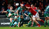 Connacht scrum half Kieran Marmion gets his box-kick away under pressure from Munster's Jack O'Donoghue Credit: ©INPHO/James Crombie