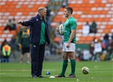 Ireland head coach Joe Schmidt passes on some instructions to Paddy Jackson, who started at out-half in place of the injured Jonathan Sexton Credit: ©INPHO/Billy Stickland