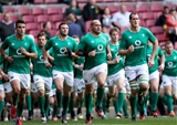 Ireland captain Rory Best leads his team-mates during the warm-up with kick-off just half an hour away Credit: ©INPHO/Billy Stickland
