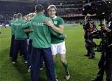 The Ireland players are congratulated by the extended members of the squad Credit: ©INPHO/Billy Stickland
