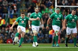 Jamie Heaslip, CJ Stander and Jack McGrath look on as Paddy Jackson fires a penalty kick to touch Credit: ©INPHO/Billy Stickland