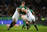 Industrious winger Andrew Trimble is sandwiched in a tackle by Siya Kolisi and Lionel Mapoe Credit: ©SPORTSFILE/Brendan Moran
