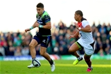 Connacht full-back Tiernan O'Halloran puts boot to ball as he puts Toulouse winger Paul Perez under pressure Credit: ©INPHO/James Crombie