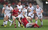 Ulster replacement back rower Clive Ross is tackled by Munster's influential Scannell brothers, Rory and Niall Credit: ©INPHO/Presseye